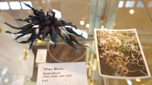 Yuka Saito's Spores Brooch and its plant life inspiration. Image courtesy of Peninsula School of Art.