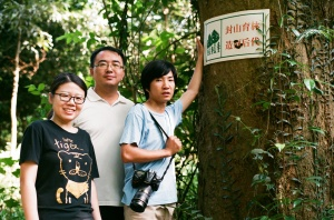 Three nature educators from the Xishanugbanna Tropical Botanic Garden, Yunnan, pictured at a habitat restoration project which involves students from a local village. One of the educators is profiled in the exhibition. Courtesy Crossed Pollinations, all rights reserved